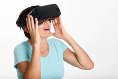 Woman looking in VR glasses and gesturing with his hands. Stock Photography
