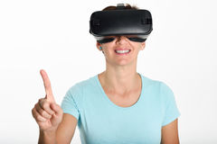 Woman looking in VR glasses and gesturing with his hands. Royalty Free Stock Images