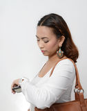 Woman looking at watch Stock Photo