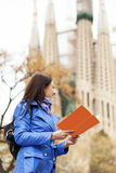 Woman looking the way on the map Stock Photos