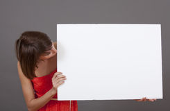 Woman looking at white banner Royalty Free Stock Photo