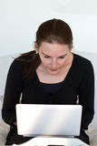 Woman Looking At White Netbook Royalty Free Stock Image