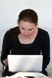 Woman Looking At White Netbook Royalty Free Stock Images