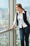 Woman looking on window Royalty Free Stock Photography