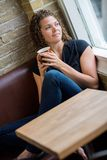 Woman Looking Through Window In Cafeteria Stock Images