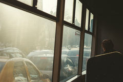 Woman looking from the window at cars stuck in traffic Stock Photo