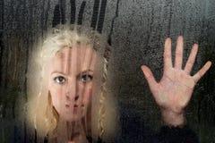 Woman looking through window Royalty Free Stock Photo