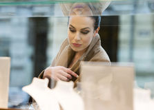 Woman looking window shop Royalty Free Stock Image