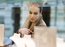 Woman looking window shop Royalty Free Stock Image