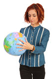 Woman looking on world globe Royalty Free Stock Image
