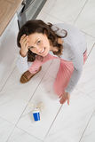 Woman Looking At Yoghurt Spilled On The Floor Stock Photo