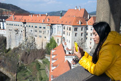 Woman on the lookout castle. Asian woman on the lookout castle Cesky Krumlov, Czech republic Royalty Free Stock Photos