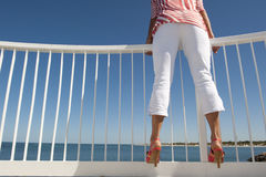 Woman at Lookout over Ocean Stock Image