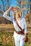Woman looks askance at the autumn colored park Stock Image