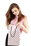 Woman looks in bag Royalty Free Stock Photography