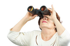 Woman looks through binocular Royalty Free Stock Image