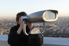 Woman looks through binoculars Stock Photography