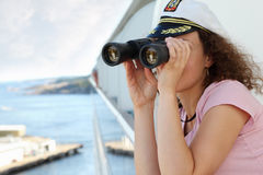 Woman looks through binoculars Royalty Free Stock Photos