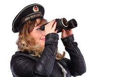 Woman looks through binoculars Royalty Free Stock Images