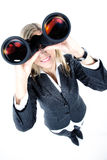 Woman looks through a binoculars Stock Photos