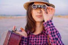 Woman looks through binoculars Royalty Free Stock Photos