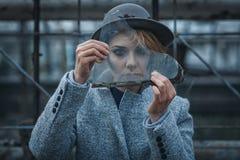 Woman looks through broken glass Royalty Free Stock Photo