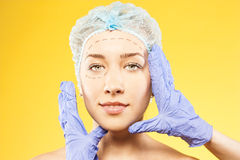 Woman looks into the camera. plastic surgery Royalty Free Stock Images