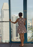 Woman looks at the city from above Stock Photos