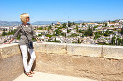 Woman looks at the city of Granada Stock Photo