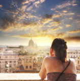 Woman looks at the city of Rome at summer sunset Royalty Free Stock Images