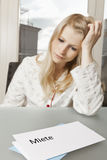 Woman looks desperate to letter Royalty Free Stock Photography