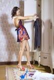 Woman looks on dress Stock Photo