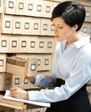 Woman Looks For Something In Card Catalog Royalty Free Stock Photography