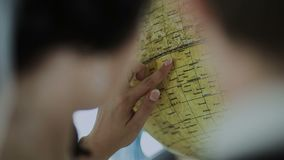 A woman looks at the globe.  stock video