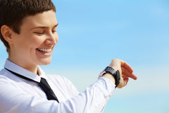 Woman looks at her watch Royalty Free Stock Photography