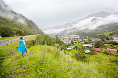 Woman looks from hill at small town. Stock Photography