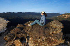 Woman looks at the landscape from Lincoln Rock Lookout at sunris Stock Photos