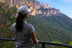 Woman looks at the landscape of The Three Sisters rock formation Stock Photography