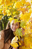 Woman looks through leaves Stock Photography