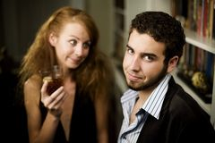 Woman looks lovingly at young man Royalty Free Stock Photography