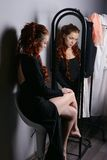 Woman looks in the mirror Royalty Free Stock Photography