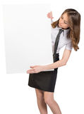 Woman looks out from behind a large blank poster Royalty Free Stock Image