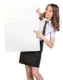 Woman looks out from behind large blank poster Stock Photo