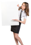 Woman looks out from behind a large blank poster Royalty Free Stock Photos
