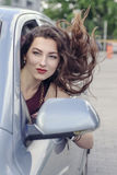 Woman looks out the car window Royalty Free Stock Image