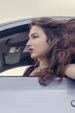Woman looks out the car window Stock Photo