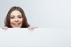 Woman looks out of pure billboard Royalty Free Stock Images