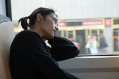 Woman looks out of tram Royalty Free Stock Image