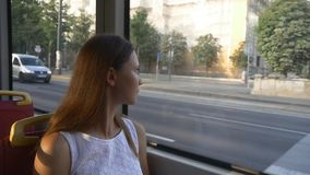 Woman looks out the window of tram stock video