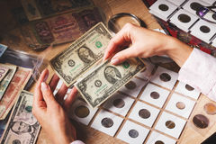 Woman looks at the page with bills in the pockets Royalty Free Stock Photography